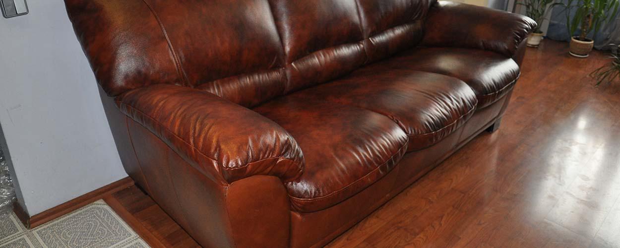 перетяжка кожаного дивана после